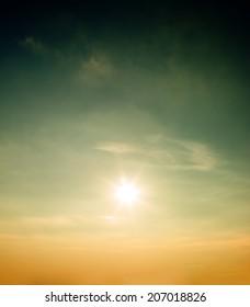 Bright sun shines in the sky.
