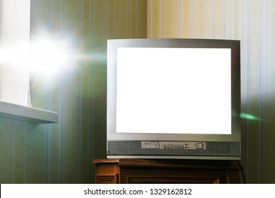bright sunbeam through the window illuminates the old TV in the room, mock up