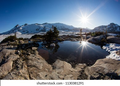Bright sunlight falls on high mountain scenery in California's Desolation Wilderness, not far from Lake Tahoe. This beautiful part of the Sierra Nevada Mountains is popular for camping and hiking.
