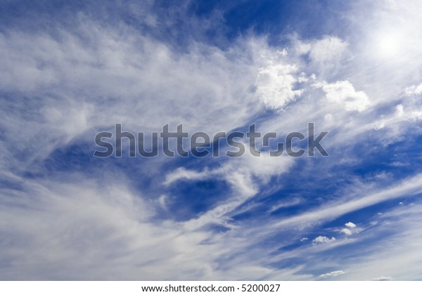 Bright sunlit cloud background showing sun