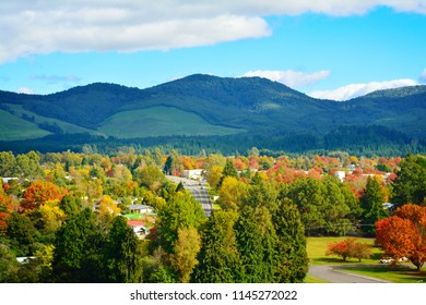 Bright and sunny autumn day in Turangi town with magnificent mountains of Tongariro National Park in the background. North Island Volcanic Plateau, New Zealand