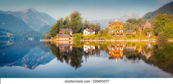 Bright sunny panorama of Gessl village. Colorful summer view of the Grundlsee lake, Liezen District of Styria, Austria, Alps. Europe. Artistic style post processed photo.