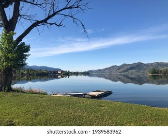 Bright sunny summer day at Osoyoos Lake with private dock - Shutterstock ID 1939583962