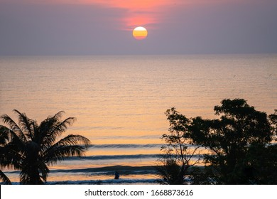 Bright Sunrise with large yellow sun under the sea surface