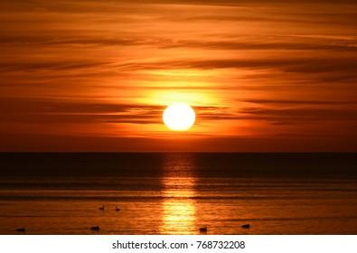 bright sunrise over the baltic sea in gdynia, poland