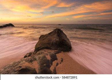 Bright sunset at Kudat Sabah Malaysia. some part of image may blur or soft focus due to slow shutter and water movement.