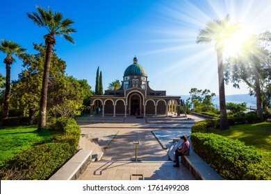 Bright sunset lights illuminate the magnificent park. Wonderful winter day. Church of the Beatitudes. High shore of Lake Tiberias. The concept of religious pilgrimage, ethnographic and photo tourism