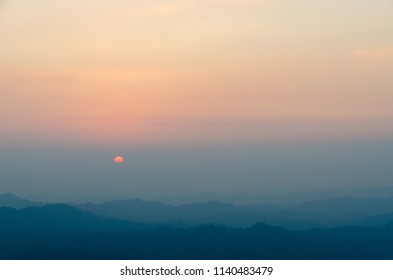 Bright sunset in mountain in summer time. Beautiful natural landscape,Kanchanaburi, Thailand