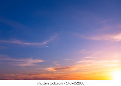 Bright sunset on a blue sky with bright sun and clouds. Natural Dawn Composition