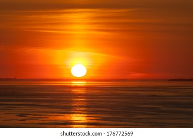 Bright sunset over the sea with clouds
