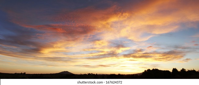 Bright sunset in sky over New Zealand landscape