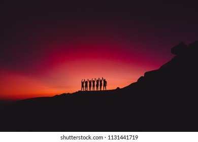 Bright sunset or sunrise and silhouette of people