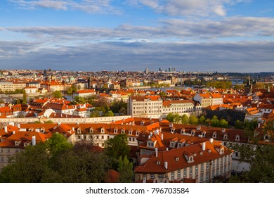 Bright sunset view of old town skyline with bridges and Vltava river from Hradcany castle. Skyline of Prague, Czech Republic