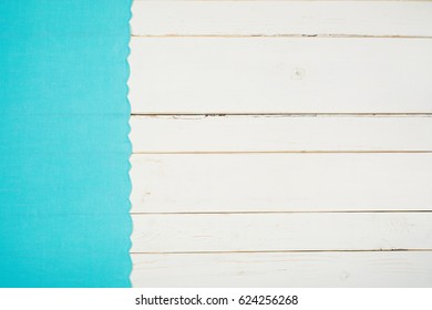 Bright Teal Fabric with Scalloped Edge laying on side of Shabby Chic Style White Wood Boards that are distressed and rustic.  There is blank space that gives room for your design, text, copy or words