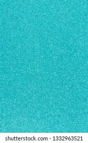Bright teal glitter paper background with copy-space for your message and useful for textures of text and objects
