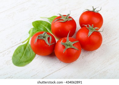 Bright tomatoes on the wood background