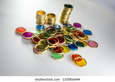 Bright and transparent colored coins to play learn to count.
