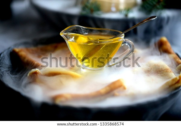Bright transparent macro photo of honey on a plate in a restaurant