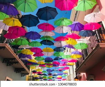 Bright Umbrellas handing above the street in Old San Juan Puerto Rico