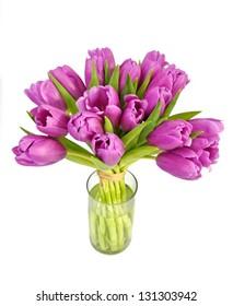 Bright violet tulips in vase