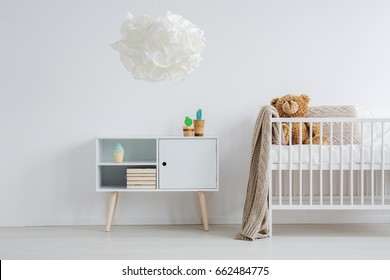 Bright and warm nursery in minimal scandi style