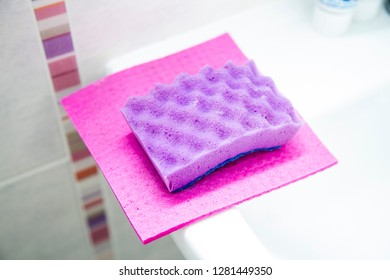bright washcloths for washing dishes on a light background