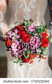 bright wedding bouquet in the hands of the bride. Red, yellow and pink flowers