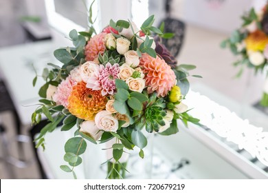 bright wedding bouquet of summer dahlias and roses