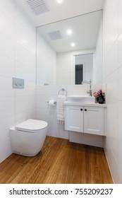 Bright white contemporary powder room