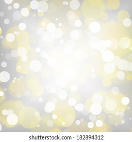 Bright white and gold bokeh on silver background