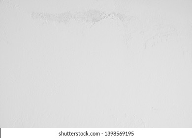 bright white, gray concrete wall with a dirty, old, rough structure in the upper part of the picture. Stone wall, cement wall in industrial style as background, wallpaper, design element, art