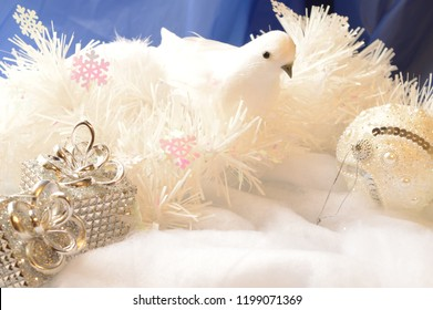 A  bright white scene of snowscape with a dove symbolizing peace for the Christmas season.