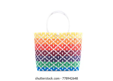 bright  wicker woman's tote bag, isolated on white background