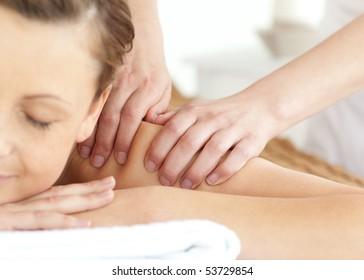 Bright woman having a massage at the spa