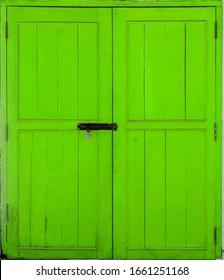 Bright wooden green door background texture, isolated.