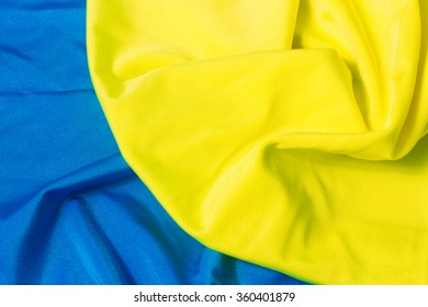 bright yellow and blue pleated fabric. As Ukrainian flag