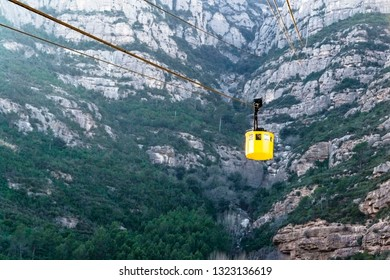Bright yellow cable car. The bottom of the Montserrat hill