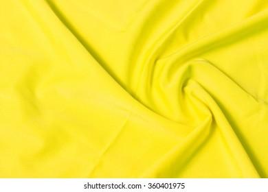 Bright yellow fabric pleated