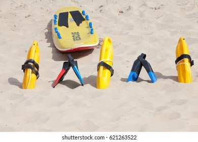 Bright yellow flotation devices and rescue equipment on the beach