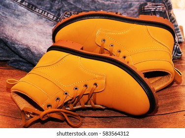 Bright yellow men's shoes and jeans