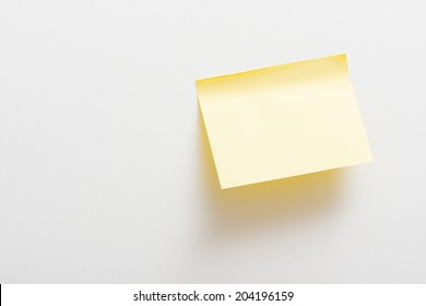 Bright Yellow paper blank on white background.