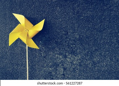 Bright yellow pinwheel on the dark blue color effect