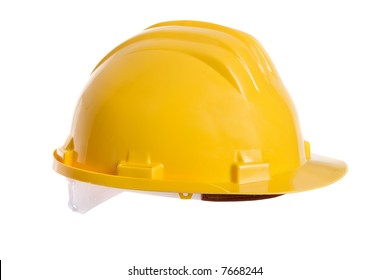 A bright yellow safety hardhat from a construction site.