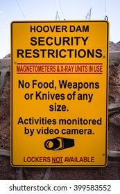 Bright yellow sign warns visitors against bringing potential terrorist items to the Hoover Dam.