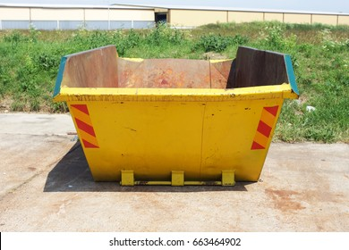 Bright yellow skip landscape