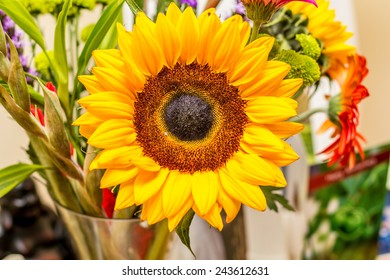 A bright yellow sunflower in a vase