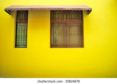 Bright yellow wall with window frame