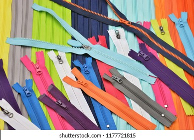 Bright zipper of different colors and variants in the textile industry