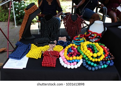Brightly colored beads displayed on market table