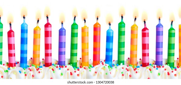 Brightly colored birthday cake candles against a white background